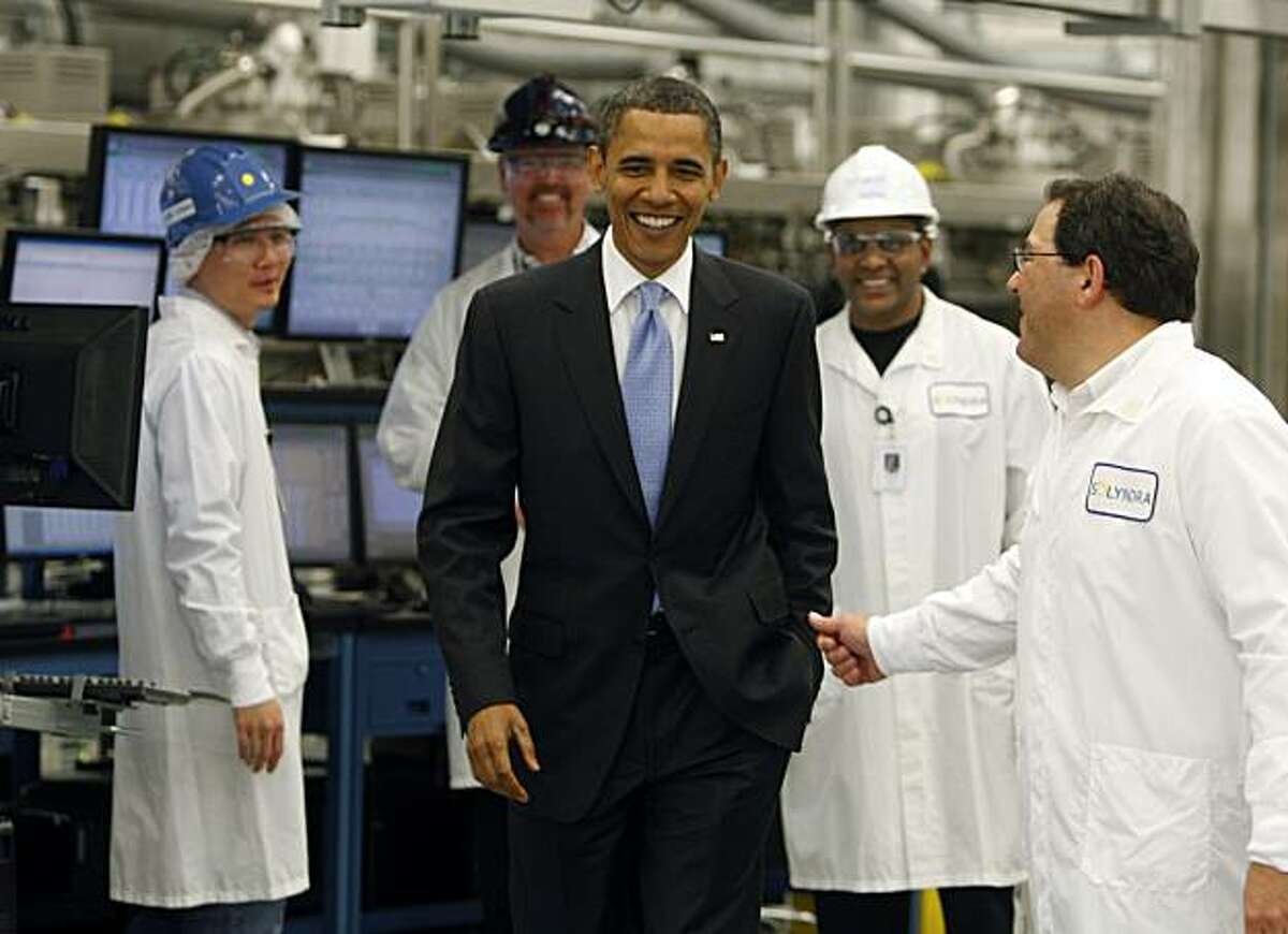 President Obama smiles during a tour of the Solyndra solar panel company in Fremont, Calif., on Wednesday, May 26, 2010.