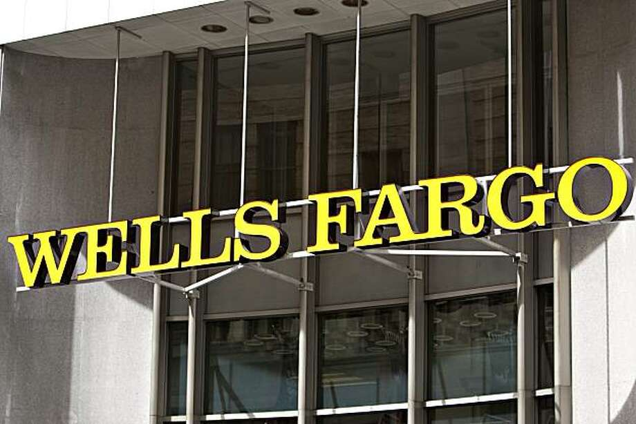 A Wells Fargo & Co. sign sits on display outside the company's offices in San Francisco, California, U.S., on Tuesday, April 27, 2010. Wells Fargo & Co., the fourth-largest U.S. bank by assets and deposits, may raise its dividend once capital levels satisfy regulators and if the economic recovery continues, said Chief Executive Officer John Stumpf. Photographer: David Paul Morris/Bloomberg Photo: David Paul Morris, Bloomberg