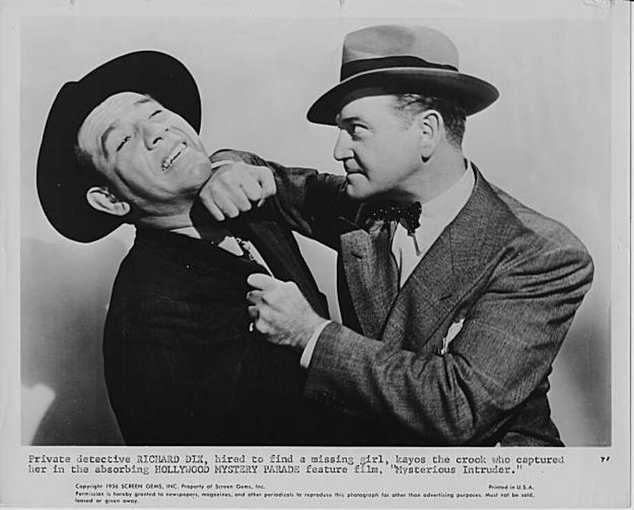 "Richard Dix (right) lays a hard one on the jaw of Mike Mazurki in MYSTERIOUS INTRUDER, a 1946 film from Columbia Pictures' ""Whistler"" series. Photo: Columbia Pictures"