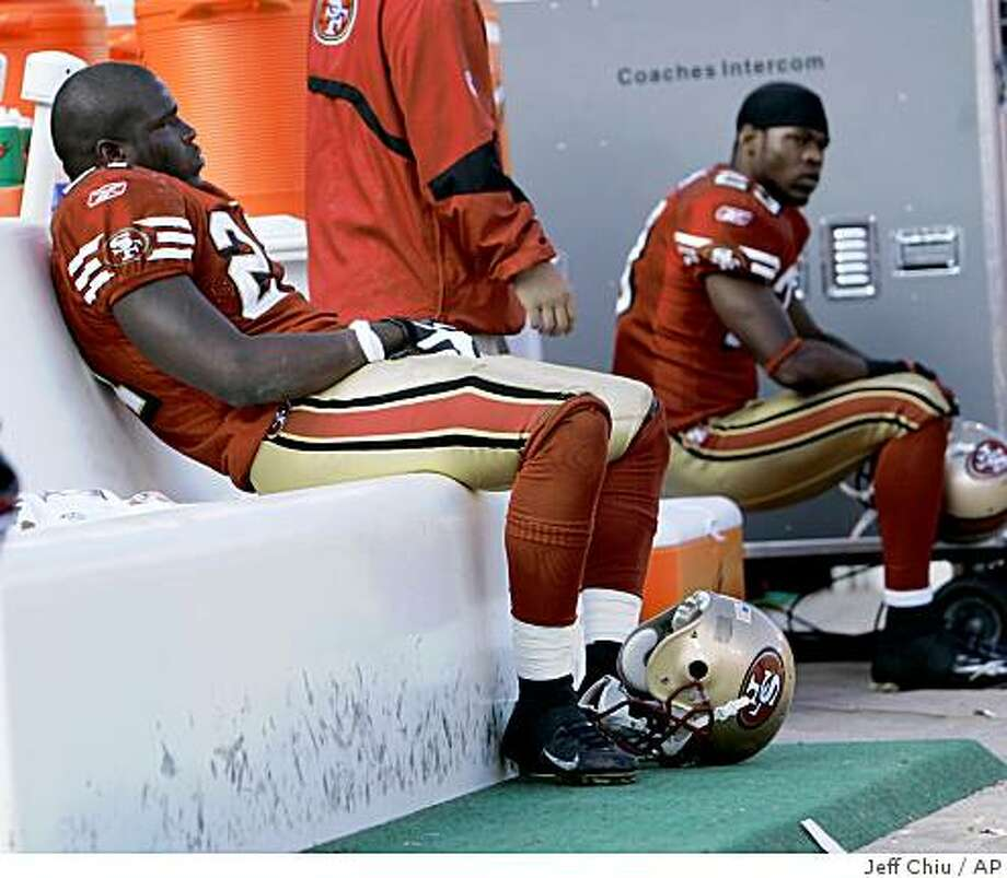 In this Oct. 5, 2008 file photo, San Francisco 49ers' Frank Gore, left, and Marcus Hudson sit on the bench in the fourth quarter against the New England Patriots in San Francisco. Photo: Jeff Chiu, AP