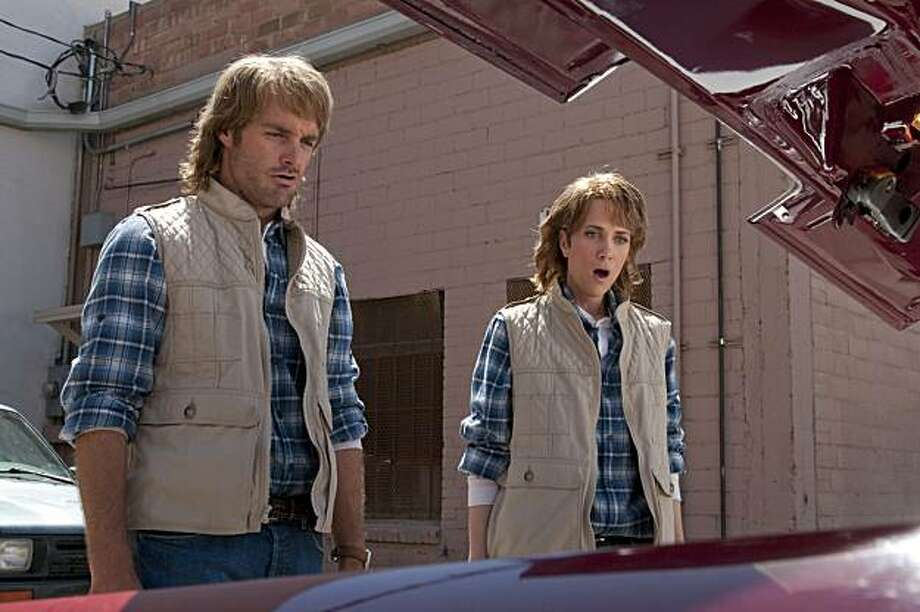 "In this film publicity image released by Rogue Pictures/Universal Pictures, Will Forte, left, and Kristen Wiig are shown in a scene from ""MacGruber."" Photo: Greg Peters, AP"