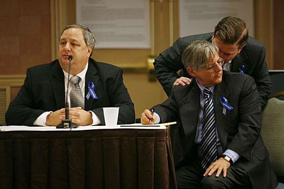 Doug Brown, left, the chief mechanic of the Deepwater Horizon, waits for questions as his attorneys Steve Gordon, sitting, and Jeff Seely whisper to each other during testimony at the Radisson Hotel in Kenner, Louisiana on Wednesday, May 26, 2010. Photo: Chris Granger, AP