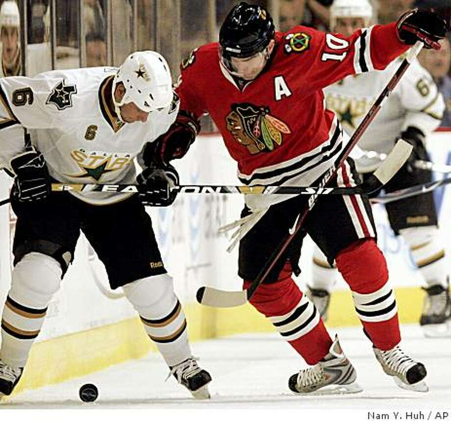 Chicago Blackhawks' Patrick Sharp, right, battles for the puck with Dallas Stars' Trevor Daley during the first period of an NHL hockey game Friday, Oct. 31, 2008, in Chicago. (AP Photo/Nam Y. Huh) Photo: Nam Y. Huh, AP