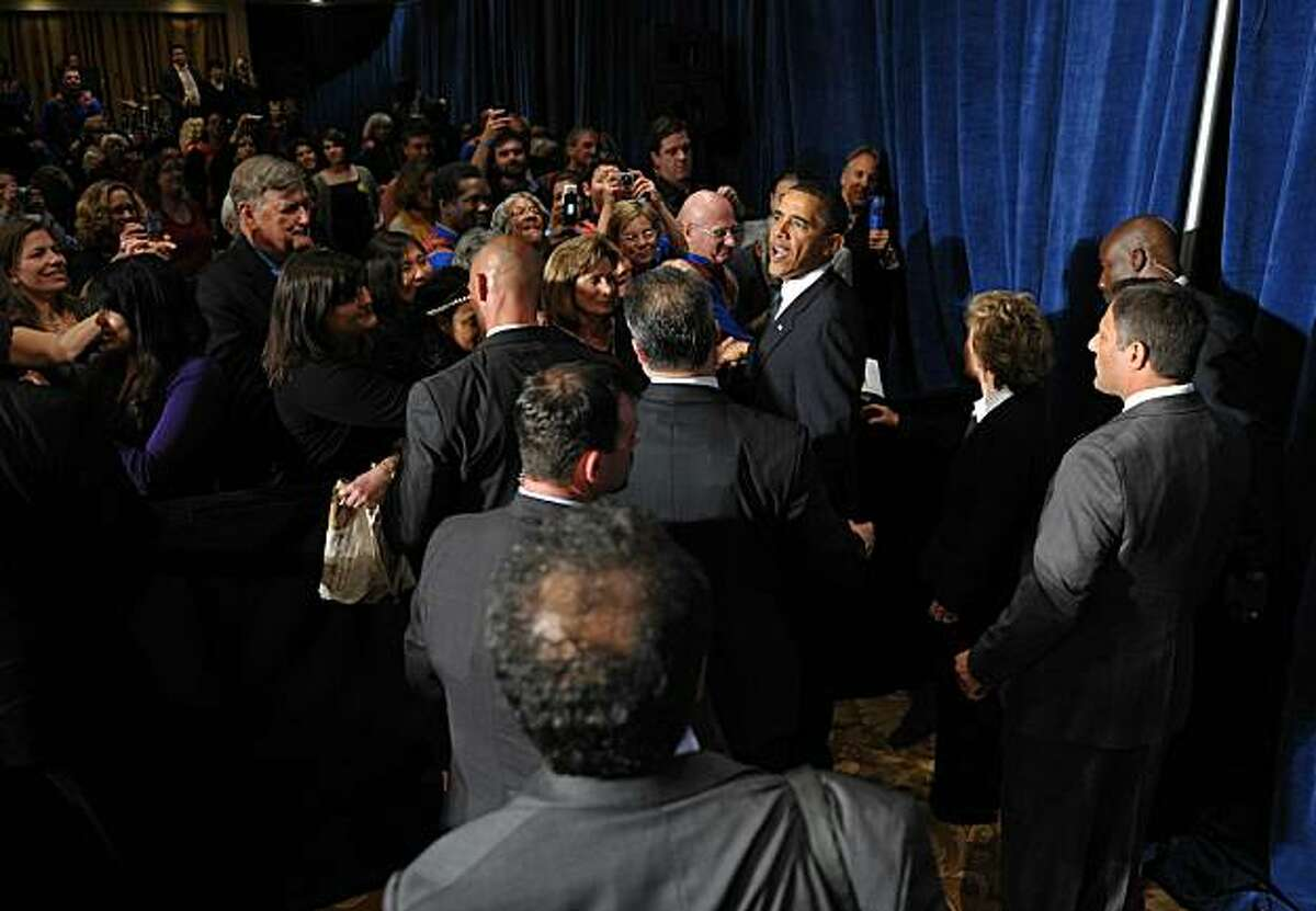 US President Barack Obama greets attendees at a fundraiser for Boxer (L) and the Democratic Senatorial Campaign Committee May 25, 2010 at the Fairmont Hotel in San Francisco.