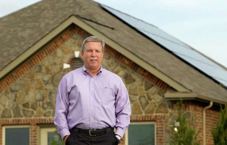 Tim Mayo, executive vice president of KB Home, displays a Zero House 2.0 in Westheimer Lakes in Richmond. The home is powered by 32 solar panels with 7.2 kilowatts of capacity. Photo: Cody Duty / © 2011 Houston Chronicle