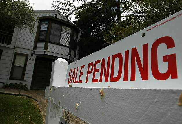 "SAN RAFAEL, CA - MAY 24:  A ""sale pending"" sign is displayed in front of a home for sale May 24, 2010 in San Rafael, California. Government incentives and low mortgage rates helped April home sales surge 7.6 percent in April, the biggest gain in five months. Photo: Justin Sullivan, Getty Images"