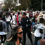 A police officer confiscates beer at the corner of Fell and Masonic in the Panhandle during the Bay to Breakers Sunday, May 16, 2010.