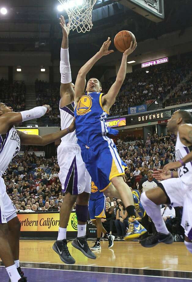Golden State Warriors guard Klay Thompson center, is fouled by Sacramento Kings center DeMarcus Cousins, second from left, during overtime in an NBA basketball game in Sacramento, Calif., Saturday, Feb. 4, 2012.  Thompson scored the game tying basket but the Kings went on to win 114-106.(AP Photo/Rich Pedroncelli) Photo: Rich Pedroncelli, Associated Press