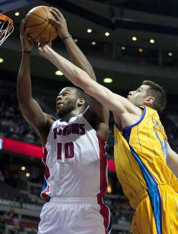 Detroit Pistons' Greg Monroe (10) grabs a rebound away from New Orleans Hornets' Jason Smith in the first half of an NBA basketball game Saturday, Feb. 4, 2012, in Auburn Hills, Mich. (AP Photo/Duane Burleson) Photo: Duane Burleson, Associated Press