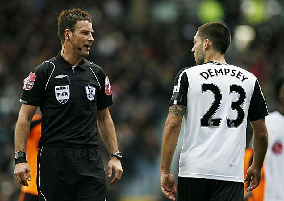Referee Mark Clattenburg (left) speaks with Fulham's US midfielder Clint Dempsey (right) during their English Premier League football match against Wigan at Craven Cottage, London, England, on April 4, 2010. Photo: Glyn Kirk, AFP/Getty Images
