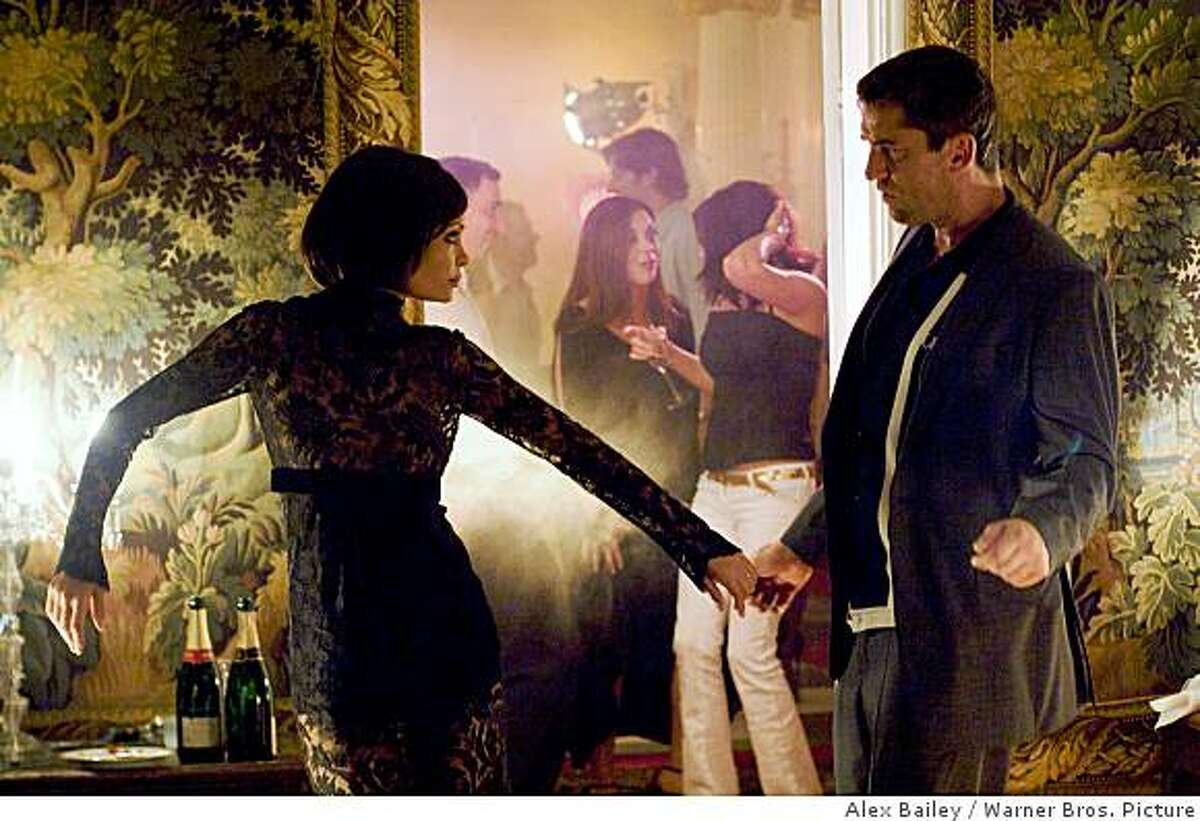 Thandie Newton as Stella and Gerard Butler as One Two in Dark Castle Entertainment?s action film ?RocknRolla,? distributed by Warner Bros. Pictures.