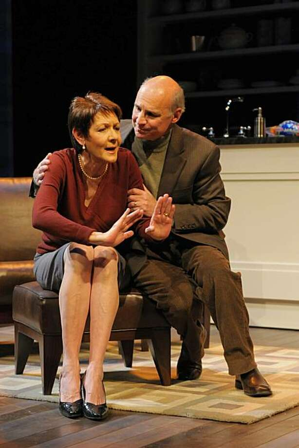 "An upset Sonia (Ivonne Coll, left) leans on her husband Daniel (Michael Santo) for comfort in Melinda Lopez's ""Sonia Flew"" at San Jose Rep Photo: Kevin Berne"