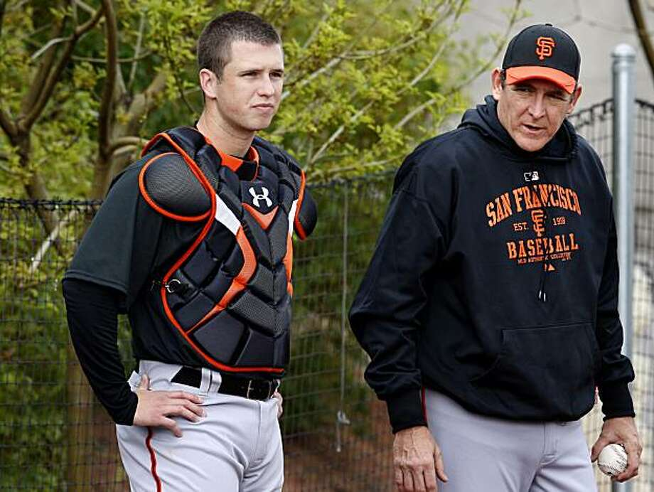 Giants catcher Buster Posey (left) and pitching coach Dave Righetti watched pitchers Monday February 22. 2010. Scenes from the San Francisco Giants and Oakland Athletics spring training campaigns of 2010 in Scottsdale and Phoenix, Arizona. Photo: Brant Ward, The Chronicle