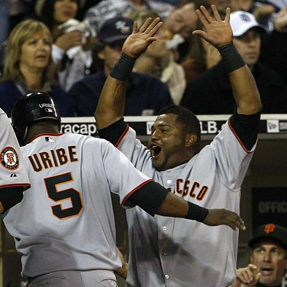 San Francisco Giants' Pablo Sandoval, right, celebrates after teammate  Juan Uribe scored in the fourth inning against the San Diego Padres in a baseball game Tuesday May 18, 2010 in San Diego. Photo: Lenny Ignelzi, AP