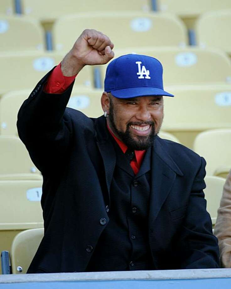 In this photo released by the Los Angeles Dodgers and taken on Friday, May 21, 2010, former Los Angeles Dodgers pitcher Jose Lima gestures before the Dodgers baseball game against the Detroit Tigers Friday, May 21, 2010 at Dodger Stadium in Los Angeles. The Dodgers say former pitcher Jose Lima died Sunday, May 23, 2010. He was 37. According to the Aguilas Cibaenas, Lima's winter ball team in the Dominican Republic, he died of an apparent heart attack. Photo: Jon SooHoo, AP