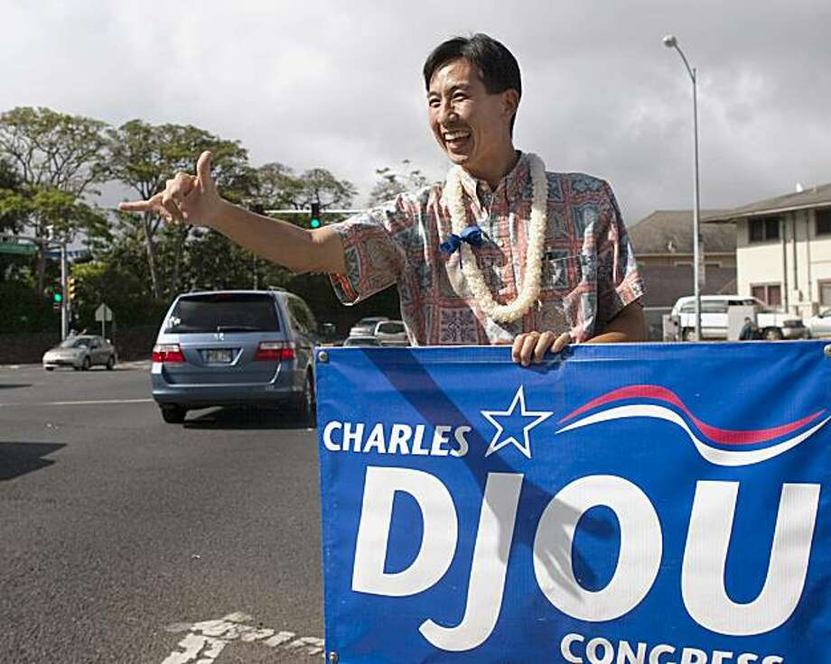 Republican candidate Charles Djou sign waves at rush hour traffic, Wednesday, May 19, 2010, in Honolulu. The special election for Hawaii's First Congressional District seat takes place Saturday between Djou and Democrats Ed Case and Colleen Hanabusa. Candidates spent the day meeting voters and sign waving in communities around Oahu. Photo: Marco Garcia, AP