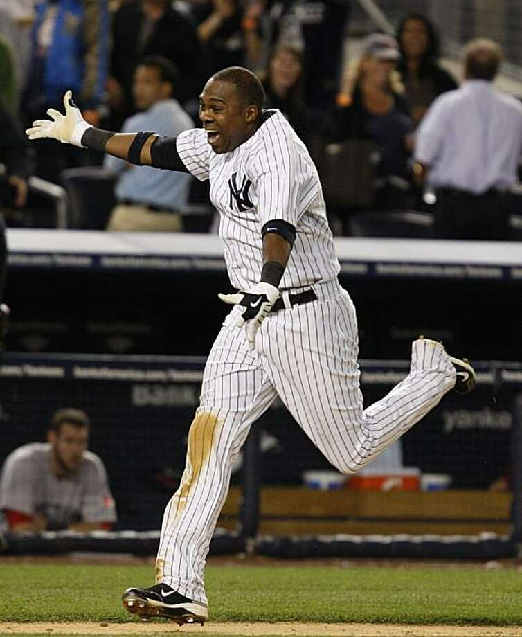 New York Yankees' Marcus Thames runs home on his walkoff home run off Boston Red Sox closer Jonathan Papelbon that gave the Yankees an 11-9 win in a baseball game at Yankee Stadium in New York, Monday, May 17, 2010. Photo: Kathy Willens, AP