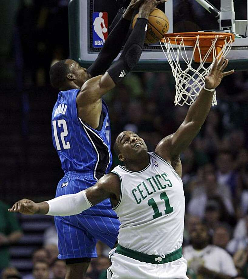Orlando Magic center Dwight Howard (12) soars to shoot over Boston Celtics forward Glen Davis (11) in the second quarter of Game 4 in the NBA Eastern Conference basketball finals in Boston, Monday, May 24, 2010. Photo: Charles Krupa, AP