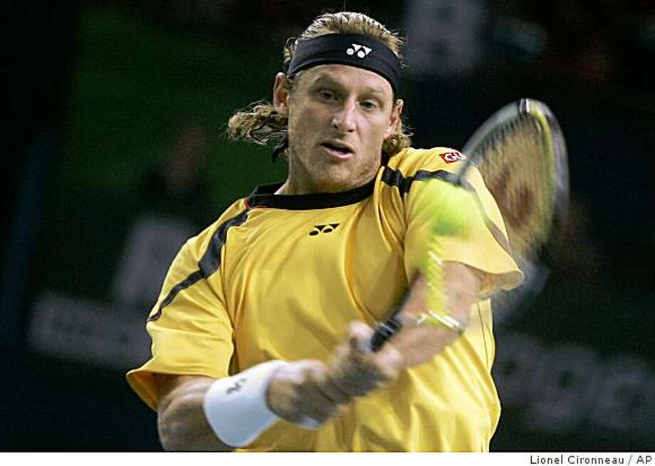 David Nalbandian of Argentina plays a return to Nicolas Kieffer of Germany during their match of the Paris Tennis Masters tournament, Wednesday, Oct. 29, 2008.(AP Photo/Lionel Cironneau) Photo: Lionel Cironneau, AP