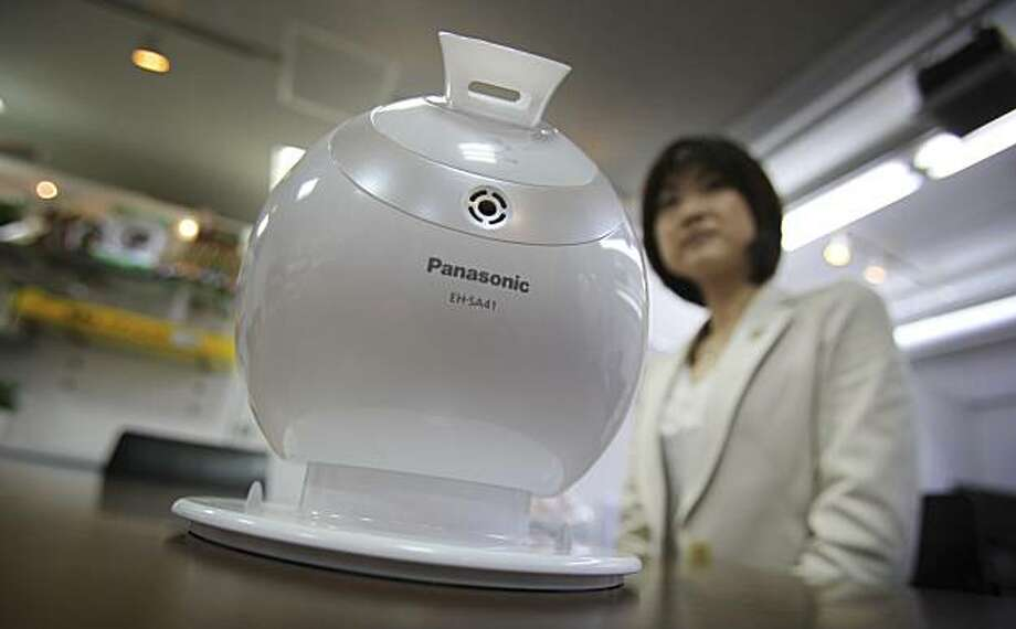 In this April 23, 2010 photo, Panasonic's beauty production development team manager Shiori Yamada stands by one of her popular products, the ball-shaped Nano Care humidifier billed as moisturizing your skin, during an interview with the Associated Pressat her office in Tokyo, Japan. It shouldn't be surprising that Panasonic's star manager for developing appliances for women is a woman herself, except that this is Japan, a nation notorious for holding back females in the workplace. Photo: Junji Kurokawa, AP