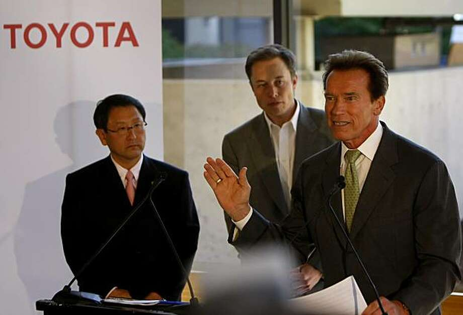 Governor Arnold Schwartzenegger announce a partnership between Toyota and Tesla Motors along with President and Chief Executive of Toyota, Akio Toyoda, left  and Chief Executive Officer of Tesla Motors Elon Musk, Thursday May 20, 2010, in Palo Alto. They will be opening the plant Nummi plant in Fremont and are expecting to create 1,000 green jobs with this merger. Photo: Lacy Atkins, The Chronicle