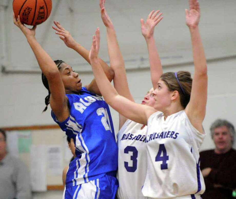 Albany High School's Breahanda Stratton (21) is defended by Catholic Central High School's Ashley Creighton (3) and Caitlin Creighton (4) during their basketball game in Troy, N.Y., Friday, Feb. 10, 2012. (Hans Pennink / Special to the Times Union) High School Sports Photo: Hans Pennink / Hans Pennink
