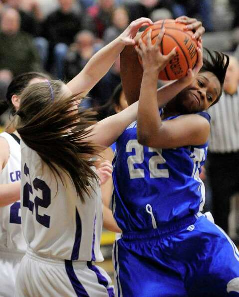 Catholic Central's Clare Herubin , left, and Albany High School's India Terrell battle for the ball