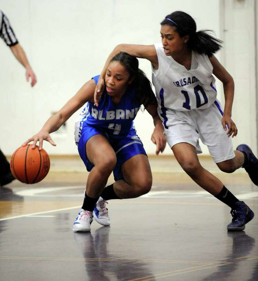 Albany High School's Emia Willingham-Hurst (4) is fouled by Catholic Central High School's Faith Welch (10) during their basketball game in Troy, N.Y., Friday, Feb. 10, 2012. (Hans Pennink / Special to the Times Union) High School Sports Photo: Hans Pennink / Hans Pennink