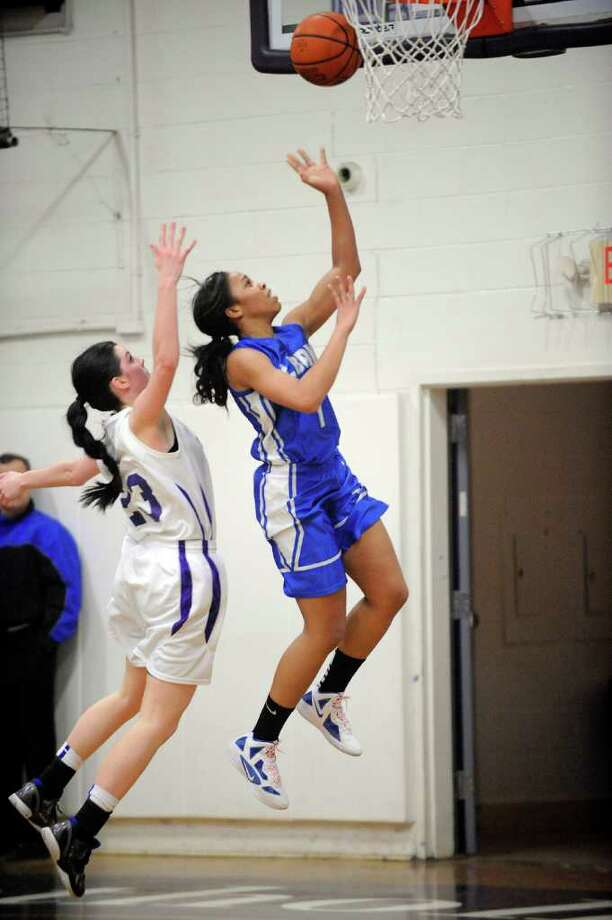 Catholic Central High School's Hannah Kutny ,left, defends against Albany High School's Emia Willingham-Hurst (4) during their basketball game in Troy, N.Y., Friday, Feb. 10, 2012. (Hans Pennink / Special to the Times Union) High School Sports Photo: Hans Pennink / Hans Pennink