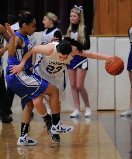 Albany High School's Madison Purcell ,left, defends against Catholic Central High School's Hannah Ku