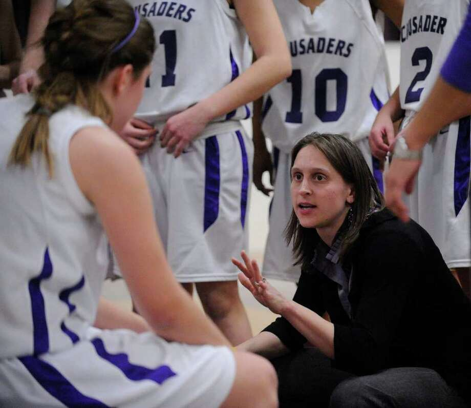 Catholic Central High School's Head Coach Audra DiBacco coaches her team against Albany High School during their basketball game in Troy, N.Y., Friday, Feb. 10, 2012. (Hans Pennink / Special to the Times Union) High School Sports Photo: Hans Pennink / Hans Pennink