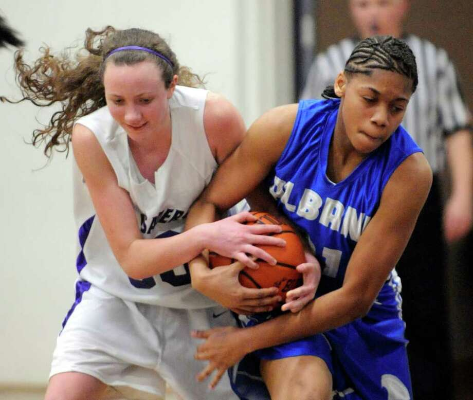 Catholic Central High School's Regan McFerran ,left, and Albany High School's Breahanda Strattpn battle for the ball during their basketball game in Troy, N.Y., Friday, Feb. 10, 2012. (Hans Pennink / Special to the Times Union) High School Sports Photo: Hans Pennink / Hans Pennink