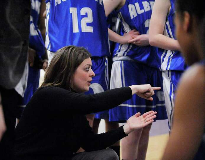 Albany High School Head Coach Kelly Haggerty MacNabb coaches her team against Catholic Central High