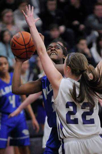 Albany High School's Dahnasia Williams ,left, is defended by Catholic Central High School's Clare He