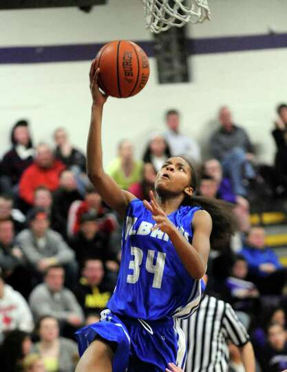 Albany High School's Mylah Chandler scores against Catholic Central High School during the basketbal