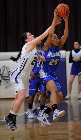 Catholic Central High School's Hannah Kutney (23) defends against Albany High School's Madison Purce