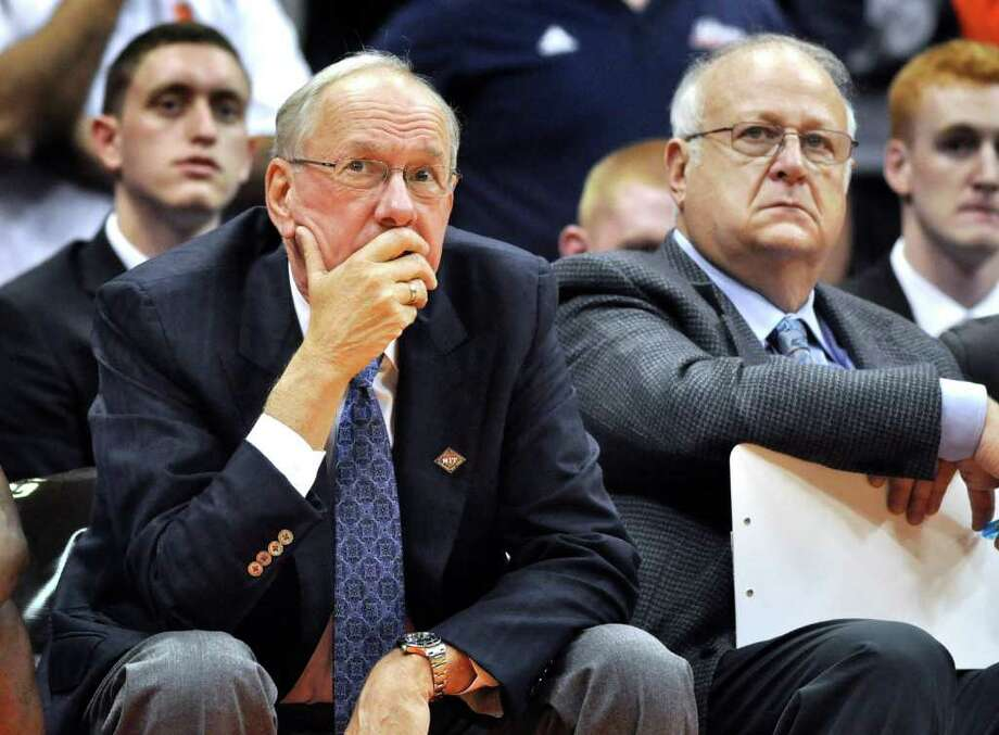 FILE - In this Nov. 14, 2011 file photo, Syracuse basketball coach Jim Boeheim, left, watches the action with assistant coach Bernie Fine,  during a college basketball game against Manhattan in the NIT Season Tip-Off in Syracuse, N.Y. Lawyers involved in a slander suit against coach Boeheim are in a New York courtroom arguing over a procedural issue that has veered into salacious allegations about fired assistant coach Bernie Fine's wife.  (AP Photo/Kevin Rivoli, File) Photo: Kevin Rivoli