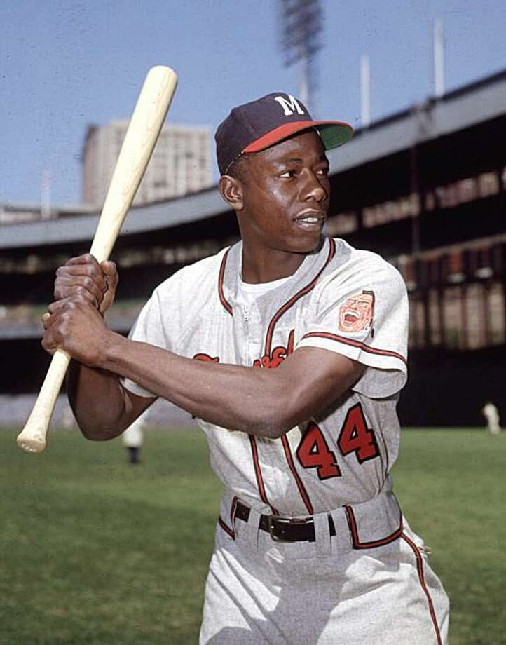 ADVANCE FOR WEEKEND of SEPT. 4-5--Hank Aaron, Milwaukee Braves' outfielder, shown in a posed batting portrait at Ebbetts Field, Brooklyn, during the exhibition season, March 1961.  As if pennant races and wild card chases aren't tough enough, now baseball wants fans to separate Cochrane from Bench, Cobb from Mays, Ruth from Aaron.(AP Photo) Photo: File, 1961, AP