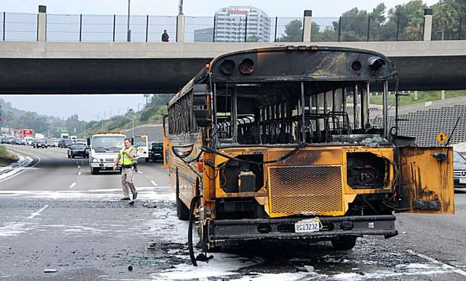A burned out school bus sits in the eastbound lanes of the 101 Freeway Wednesday May 19, 2010 in Los Angeles. Motorists jumped from vehicles to kick open doors and help 23 third-graders out of this blazing school bus that had stalled on a busy freeway Wednesday near Universal Studios Hollywood, authorities and witnesses said. Photo: Miike Meadows, AP
