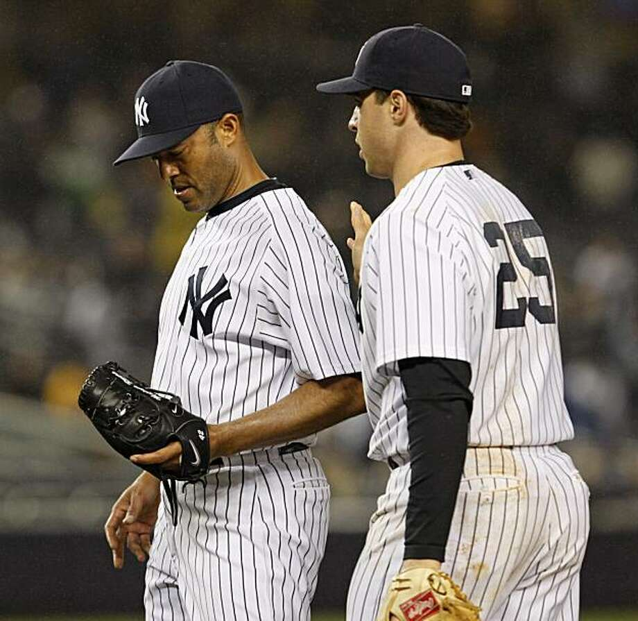 New York Yankees first baseman Mark Teixeira consoles closer Mariano Rivera after Marco Scutaro reached on Marcus Thames' ninth-inning error in the Red Sox's 7-6 victory over the Yankees in their baseball game at Yankee Stadium in New York, Tuesday, May 18, 2010. Photo: Kathy Willens, AP