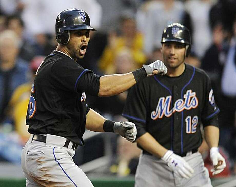 New York Mets' Angel Pagan, left, celebrates his inside-the-park home run as Jeff Francoeur (12) looks on during the fourth inning of a baseball game against the Washington Nationals, Wednesday, May 19, 2010, in Washington. Photo: Nick Wass, AP