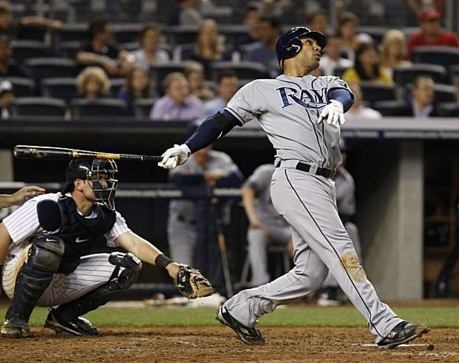 Tampa Bay Rays' Carlos Pena follows through on his eighth-inning solo home run off New York Yankees reliever Chan Ho Park in a baseball game at Yankee Stadium in New York, Thursday, May 20, 2010. It was Pena's second home run in the game. Photo: Kathy Willens, AP