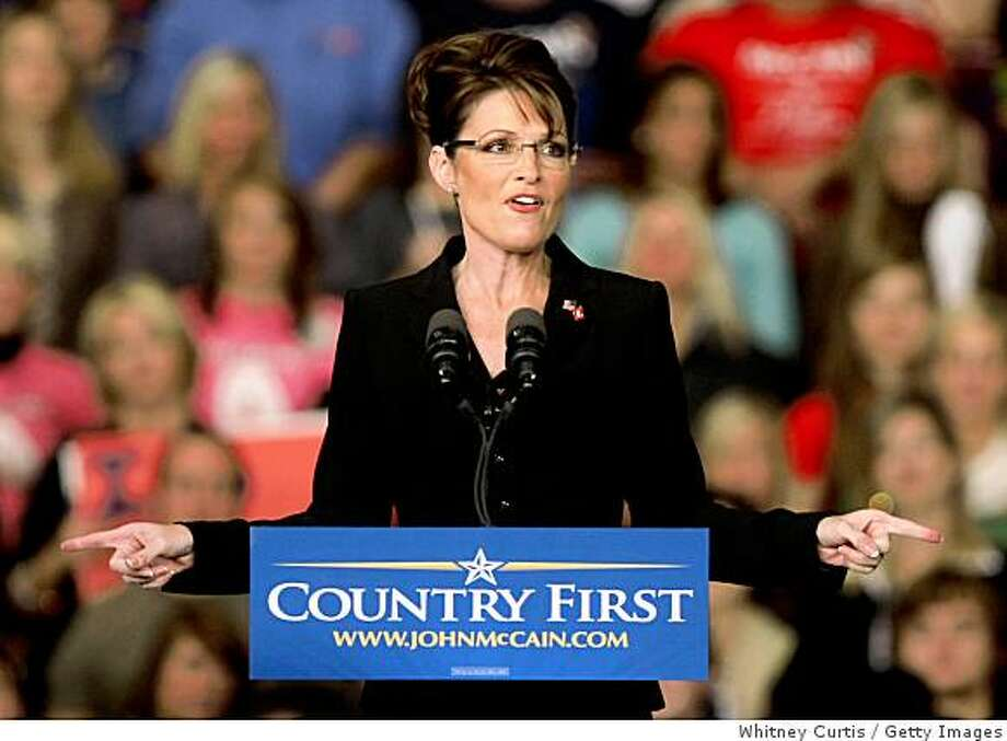 CAPE GIRARDEAU, MO - OCTOBER 30:  Republican U.S. vice presidential Candidate Alaska Gov. Sarah Palin speaks during a campaign rally at Show Me Center October 30, 2008 in Cape Girardeau, Missouri. Palin and Republican presidential nominee Sen. John McCain (R-AZ) continue to campaign in battlegrounds states like Missouri where polls are showing McCain and Democratic presidential nominee U.S. Sen. Barack Obama (D-IL) in a dead heat before the election on November 4.  (Photo by Whitney Curtis/Getty Images) Photo: Whitney Curtis, Getty Images
