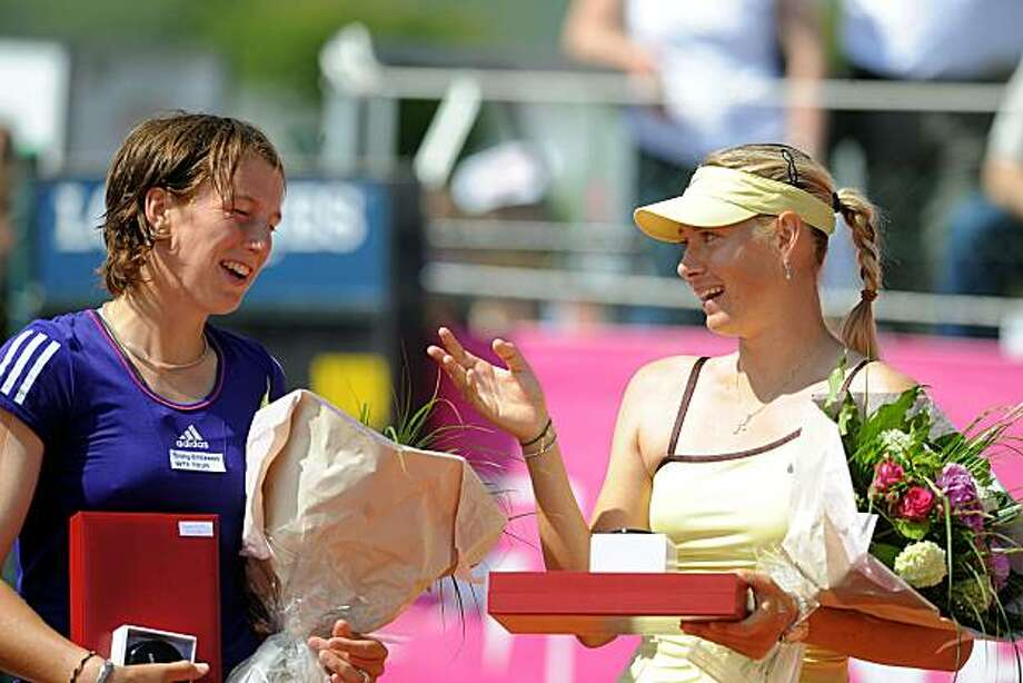 Russia's Maria Sharapova, right, holds flowers after defeating Germany's Kristina Barrois, left, in their WTA tennis tournament final in Strabourg, eastern France, Saturday May 22, 2010.  Sharapova won 7-5/ 6-1. Photo: Cedric Joubert, AP