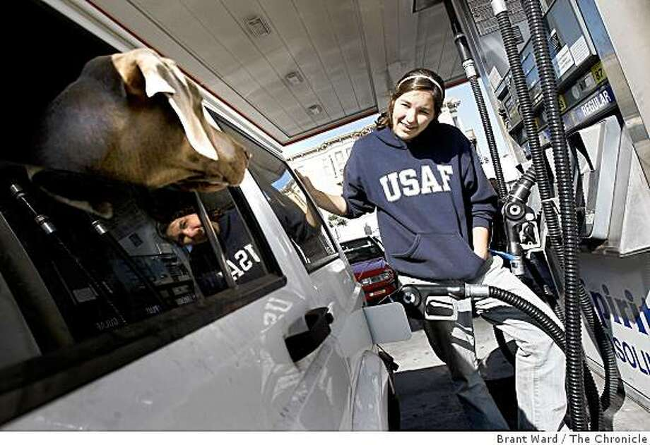 Susan Blanchard, who has a dog walking business in San Francisco, saved $20 Wednesday when she filled up her Jeep up at the Spirit station at Fell and Divisadero Streets in San Francisco on Wednesday October 29, 2008. Photo: Brant Ward, The Chronicle
