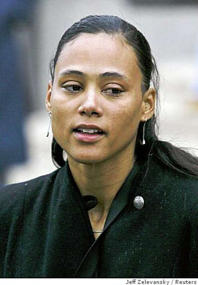 Former Olympic medalist Marion Jones speaks to reporters after sentencing at the U.S. Federal Courthouse in White Plains, New York, in this January 11, 2008 file photo. To match feature OLYMPICS-DOPING/    REUTERS/Jeff Zelevansky/Files (UNITED STATES) Photo: Jeff Zelevansky, Reuters