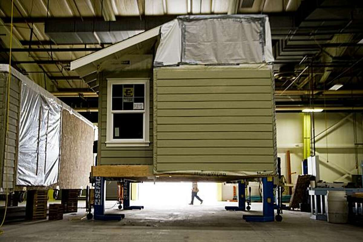 A second story of a prefab house waits to be place on a trailer and shipped out of the plant.
