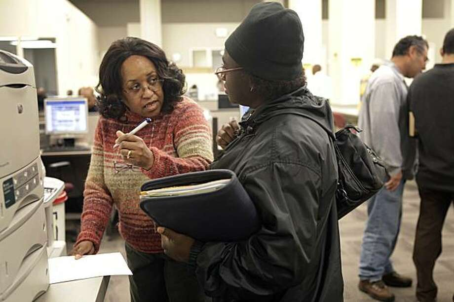 Gail Ford of Oakland (right) gets tips from Oneida Hendrix, employment program representative for the Oakland Career Center (right) on how to search for jobs on the internet at the Oakland Career Center in Oakland, Calif. on Monday May 17, 2010. Photo: Lea Suzuki, The Chronicle