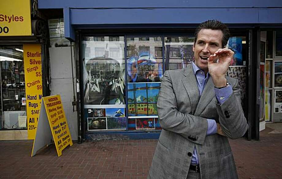 Mayor Gavin Newsom along the 1000 block of Market Street, shares his vision of how he would like the corridor to look. Mayor Newsom walks along Market Street in San Francisco, Calif. on Wednesday Apr. 14, 2010, the Mid-Market Street  corridor has seen some improvements and others which are slow in coming. Photo: Michael Macor, The Chronicle