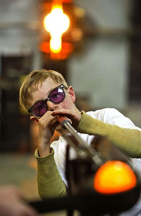 Theoren Hanks blows glass as he creates a glass bowl on Wednesday Apr. 28, 2010, in San Francisco, Calif. 9-year-old Thearon Hanks of Sacramento makes a trip down to San Francisco to the Public Glass studio in the Bayview to sculpt and blow hot glass, a passion he picked up at age 8. Photo: Michael Macor, The Chronicle